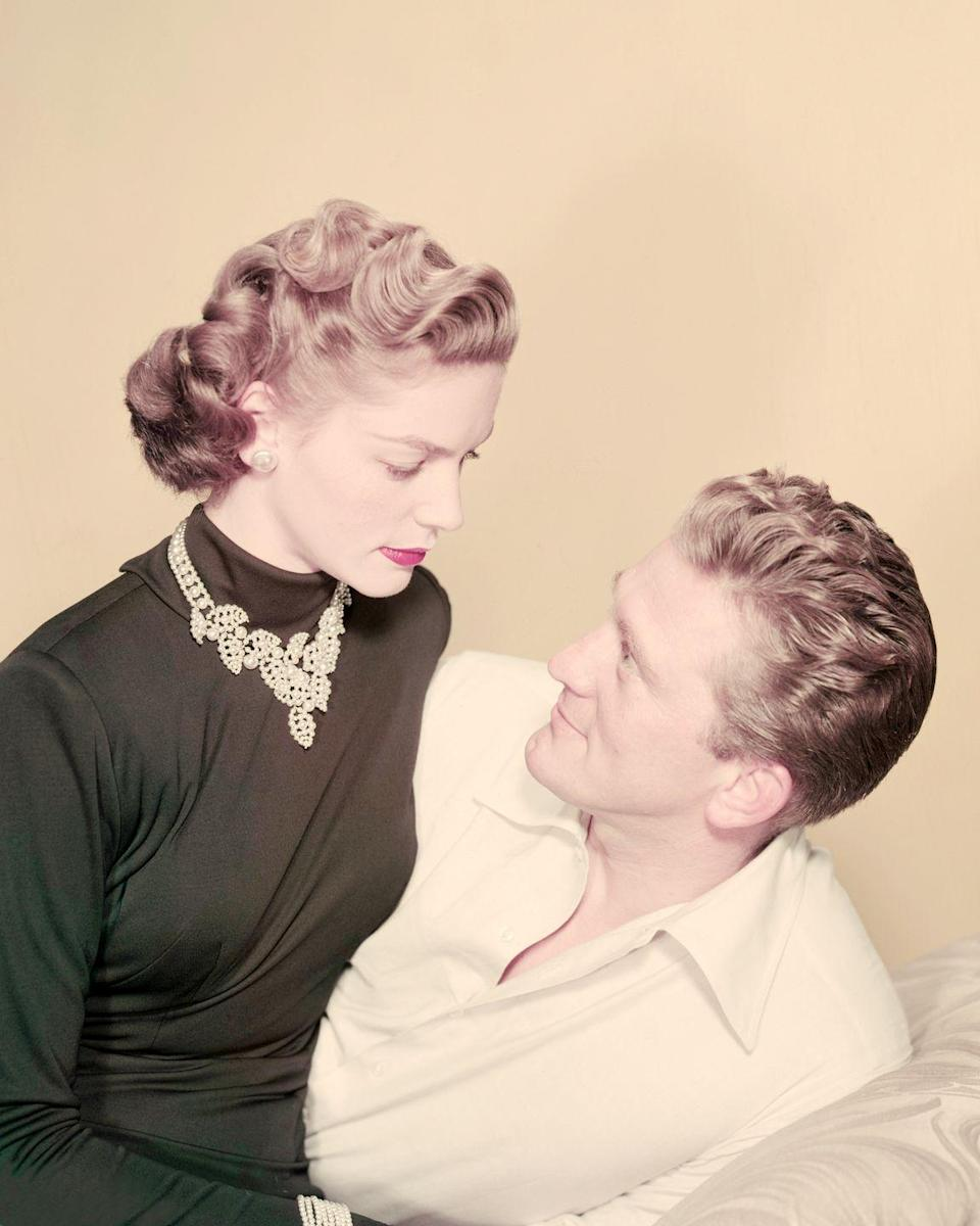 <p>Douglas poses with his costar Lauren Bacall in a promotional portrait for <em>Young Man With a Horn</em>. </p>