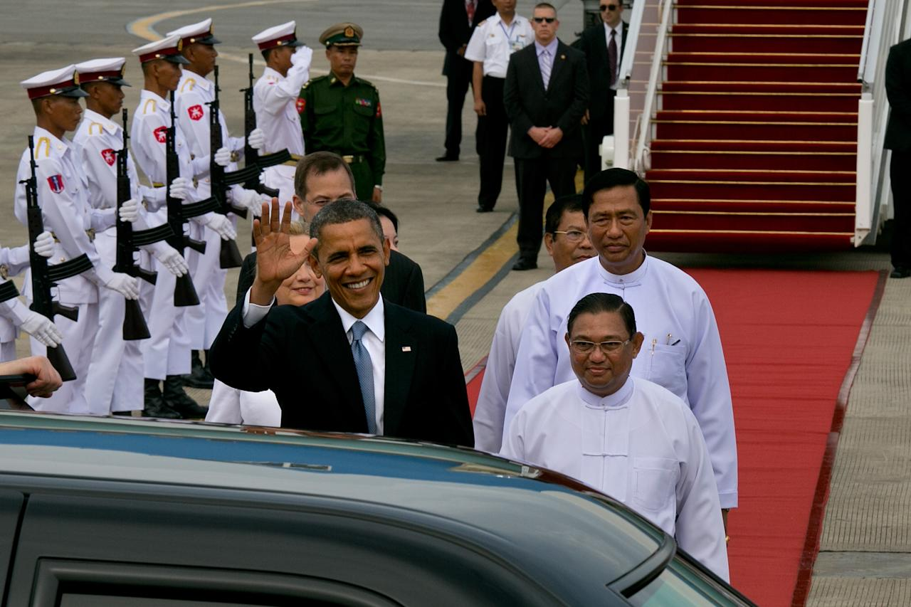 YANGON, MYANMAR - NOVEMBER 19: US President Barack Obama alongside Secretary of State Hilary Clinton (L) chat with Burmese Foreign minister Wunna Maung Lwin (R) as they arrive at Yangon International airport during a historical visit to the country on November 19, 2012 in Yangon, Myanmar. Obama is the first US President to visit Myanmar while on a four-day tour of Southeast Asia that also includes Thailand and Cambodia. (Photo by Paula Bronstein/Getty Images)