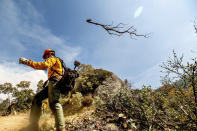 A member of the Roosevelt Hotshot Crew clears a firebreak while battling the Windy Fire on Thursday, Sept. 16, 2021, on the Tule River Reservation, Calif. His crew, which travelled from Colorado, has been battling California wildfires. (AP Photo/Noah Berger)