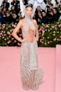 """<p>EmRata makes the list again, this time with her <a href=""""https://www.cosmopolitan.com/uk/fashion/celebrity/g27383773/met-gala-2019-naked-dresses/?slide=2"""" rel=""""nofollow noopener"""" target=""""_blank"""" data-ylk=""""slk:2019 Met Gala look"""" class=""""link rapid-noclick-resp"""">2019 Met Gala look</a>, when she dressed as a heavenly being in this bold cut-out number by Dundas.</p>"""