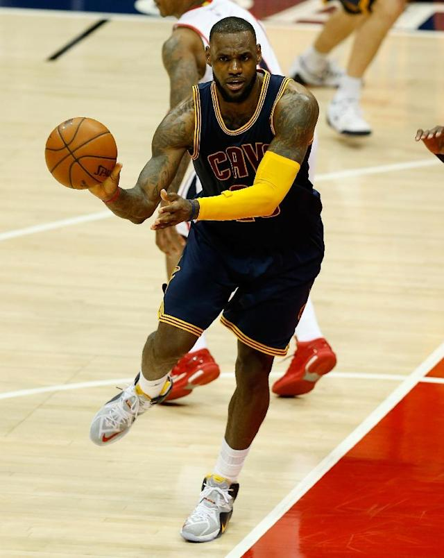 LeBron James of the Cleveland Cavaliers passes during game one of the Eastern Conference finals against the Atlanta Hawks at Philips Arena in Atlanta, Georgia, on May 20, 2015 (AFP Photo/Mike Zarrilli)