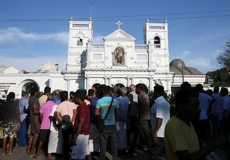 Locals stand in front of St Anthony's shrine in Colombo, after bomb blasts ripped through churches and luxury hotels on Easter, in Sri Lanka April 22, 2019. REUTERS/Athit Perawongmetha