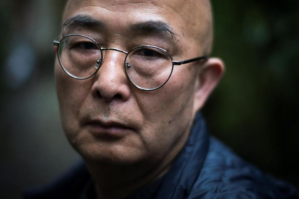 Liao Yiwu was jailed for writing a poem called 'Massacre' about the Tiananmen Square protests (AFP Photo/Lionel BONAVENTURE)