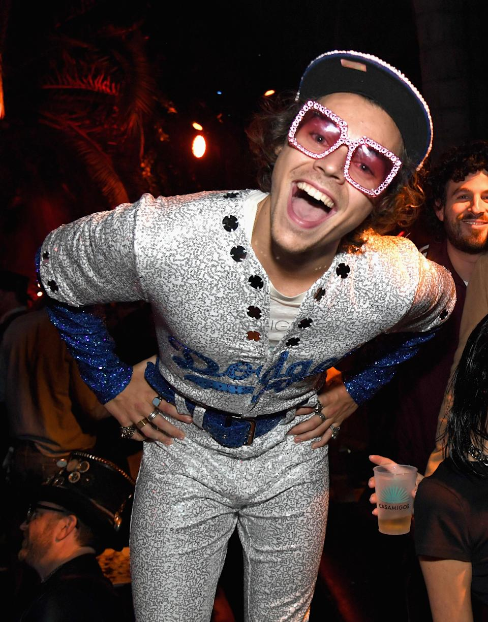 <p>Harry Styles dressed like close pal Elton John for the Casamigos Halloween party with a pair of the singer's famous bejewelled sunnies to finish. <em>[Photo: Getty]</em> </p>