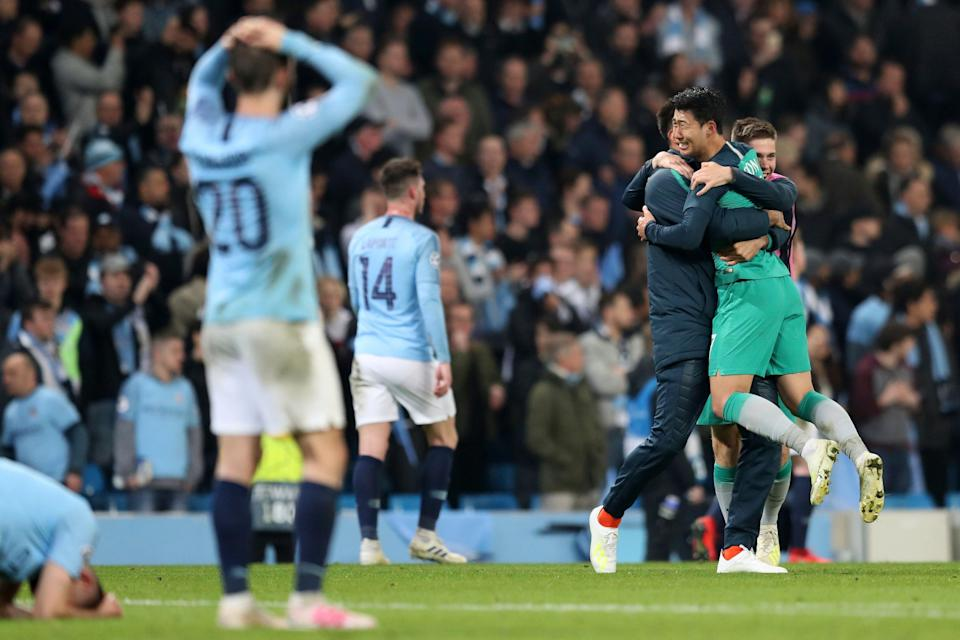Tottenham Hotspur forward Son Heung-Min, right, celebrates as Manchester City players react after the Champions League quarterfinal, second leg, soccer match between Manchester City and Tottenham Hotspur at the Etihad Stadium in Manchester, England, Wednesday, April 17, 2019. (AP Photo/Jon Super)