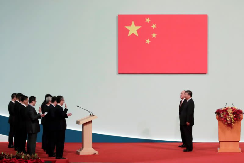 Chinese President Xi Jinping, new Macau Chief Executive Ho Iat-seng and members of the new government attend a ceremony on the 20th anniversary of the former Portuguese colony's return to China in Macau