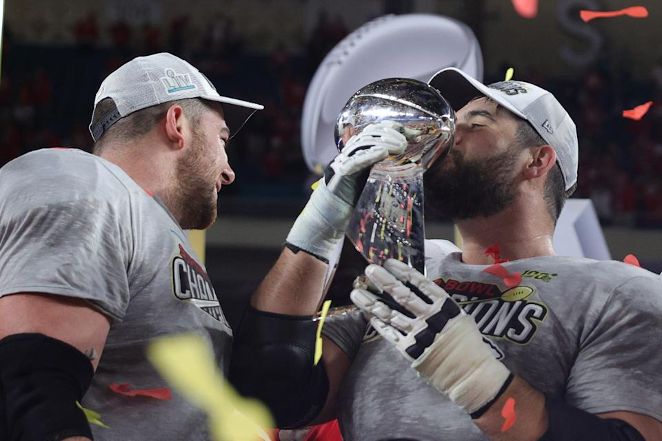 MIAMI, FLORIDA - FEBRUARY 02: Laurent Duvernay-Tardif #76 of the Kansas City Chiefs celebrates with the Vince Lombardi Trophy after defeating the San Francisco 49ers 31-20 in Super Bowl LIV at Hard Rock Stadium on February 02, 2020 in Miami, Florida. (Photo by Tom Pennington/Getty Images)