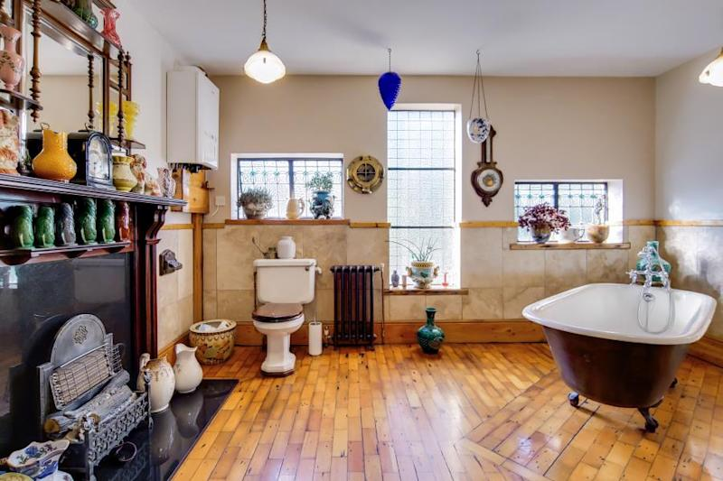 The bathroom features a cast iron bath tub. Photo: Fine & Country