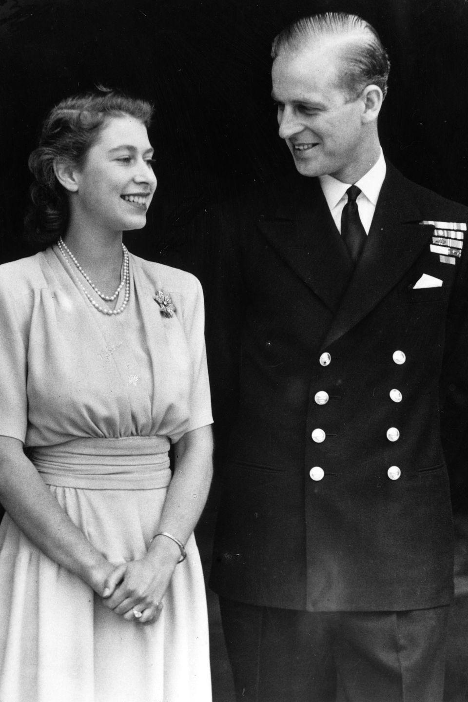 <p>The couple shares a moment together shortly after announcing their engagement at Buckingham Palace in London. The two initially met when they were very young at the wedding of Phillip's cousin and Elizabeth's uncle. It wasn't until years later at the Royal Naval College in Dartmouth when they really began their romantic relationship. </p>