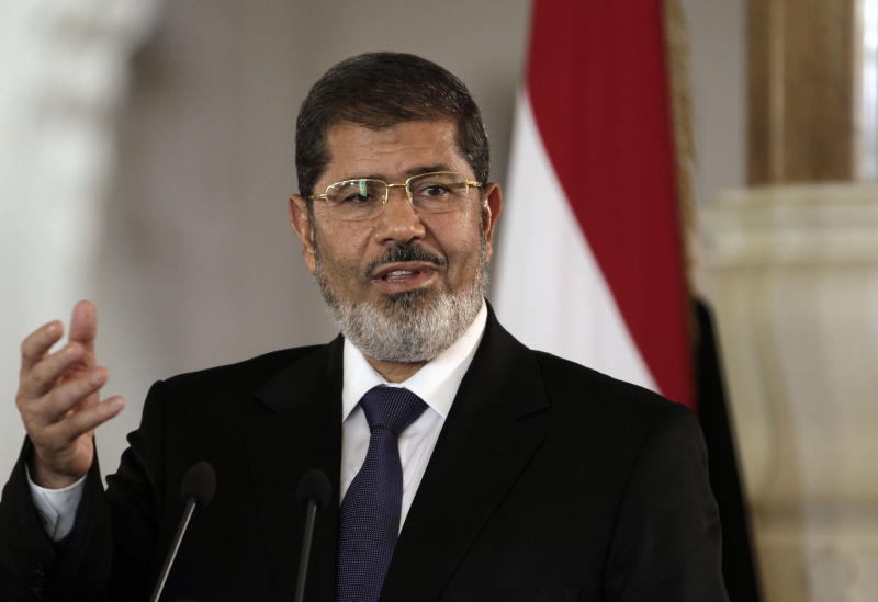 FILE - In this Friday, July 13, 2012 file photo, Egyptian President Mohammed Morsi speaks to reporters during a joint news conference with Tunisian President Moncef Marzouki, unseen, at the Presidential palace in Cairo, Egypt. Egypt's Islamist president may hail from the fiercely anti-Israeli Muslim Brotherhood, but in his first major crisis over Israel, he is behaving much like his predecessor, Hosni Mubarak:. He recalled the ambassador and engaged in empty rhetoric supporting Palestinians. Mohammed Morsi is under pressure at home to do more but he is just as wary as Mubarak about straining ties with the United States. (AP Photo/Maya Alleruzzo, File)