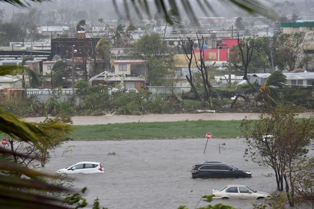 <p>A parking lot is flooded near Roberto Clemente Coliseum in San Juan, Puerto Rico, on Sept. 20, 2017, during Hurricane Maria. (Photo: Hector Retamal/AFP/Getty Images) </p>