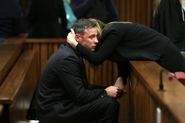 Oscar Pistorius is seen with sister Aimee after proceedings on the third day of his resentencing hearing for the 2013 murder of his girlfriend Reeva Steenkamp in the North Gauteng High Court in Pretoria, South Africa June 15, 2016. REUTERS/Alon Skuy/Pool TPX IMAGES OF THE DAY