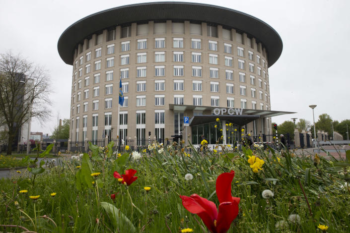 -FILE- In this Friday, April 21, 2017, image the headquarters of the Organisation for the Prohibition of Chemical Weapons, OPCW, are seen in The Hague, Netherlands. Russia came under renewed pressure to explain the nerve agent attack on opposition figure Alexei Navalny as the annual meeting of the global chemical weapons watchdog got underway Monday Nov. 30, 2020, amid measures aimed at reining in the spread of the coronavirus. (AP Photo/Peter Dejong)