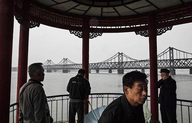 "<p>The ""Friendship Bridge"" is seen in the background as Chinese men take part in morning exercises on the Yalu river in the border city of Dandong, Liaoning province, northern China across from the city of Sinuiju, North Korea on May 23, 2017 in Dandong, China. (Photo: Kevin Frayer/Getty Images) </p>"