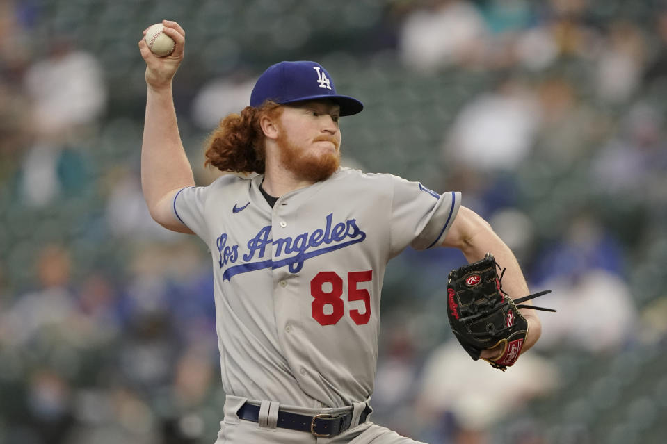 Los Angeles Dodgers starting pitcher Dustin May throws against the Seattle Mariners during the first inning of a baseball game, Monday, April 19, 2021, in Seattle. (AP Photo/Ted S. Warren)
