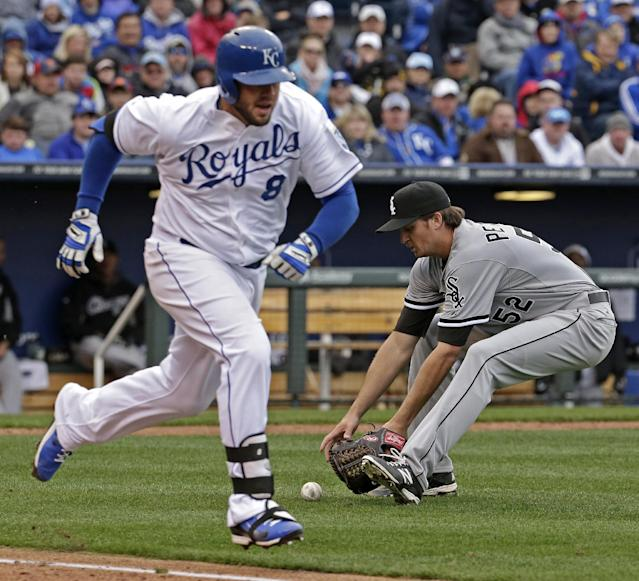 Chicago White Sox pitcher Jake Petricka (52) fields a ball hit by Kansas City Royals' Mike Moustakas (8) before throwing to first for the out during the sixth inning of a home opener baseball game on Friday, April 4, 2014, in Kansas City, Mo. (AP Photo/Charlie Riedel)