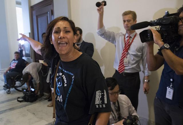 <p>A protestor against the Senate Republican's draft healthcare bill shouts outside the office of Senate Majority Leader Mitch McConnell, Republican of Kentucky, on Capitol Hill in Washington, June 22, 2017. (Photo: Saul Loeb/AFP/Getty Images) </p>