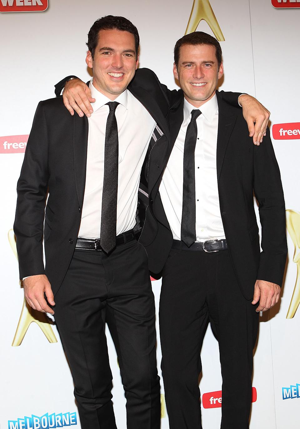 Karl Stefanovic and his brother Pete Stefanovic pose in the media room during the 2011 Logie Awards at Crown Palladium