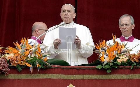 "Pope Francis delivers his ""Urbi et Orbi"" (""to the city and the world"") message, in St. Peter's Square - Credit: AP"