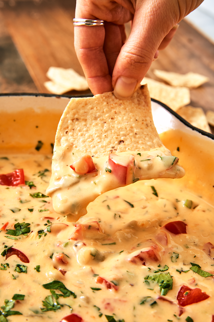 """<p>Queso is almost always a crowdpleaser, and homemade queso will be sure to feel like a treat for your loved ones. </p><p><em><strong>Get the recipe at </strong></em><em><strong><a href=""""https://www.delish.com/cooking/recipe-ideas/a25647686/queso-dip-recipe/"""" rel=""""nofollow noopener"""" target=""""_blank"""" data-ylk=""""slk:Delish"""" class=""""link rapid-noclick-resp"""">Delish</a>.</strong></em></p>"""