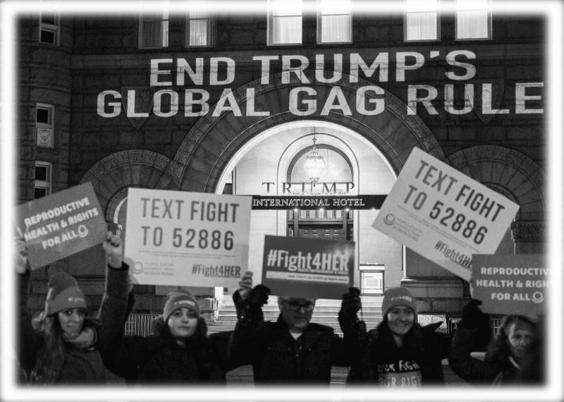Activists hold signs as they project a message onto the Trump International Hotel, to protest the Global Gag Rule which bans health care providers that receive US global health aid from referring, providing or discussing abortion with their patients, during a demonstration in Washington, DC on January 23, 2019. (Photo: Andrew Caballero-Reynolds/AFP/Getty Images; digitally enhanced by Yahoo News)