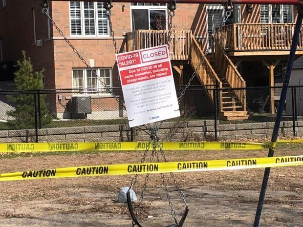 Playgrounds in city parks across Toronto were taped off and closed to avoid the spread of COVID-19 in the early part of the pandemic. (Kirthana Sasitharan/CBC - image credit)