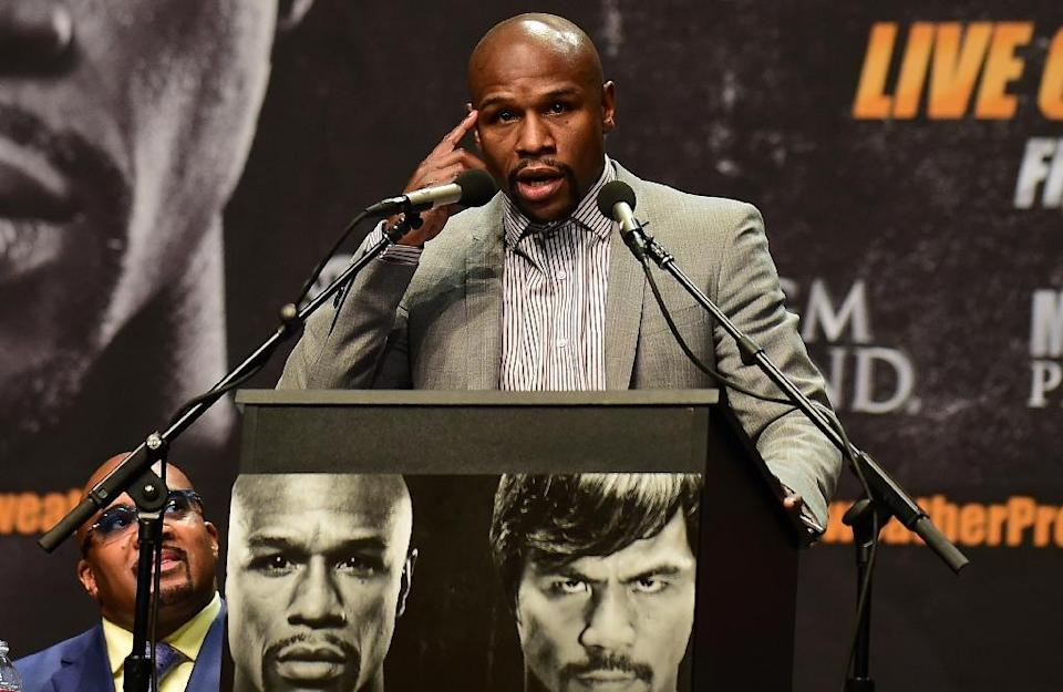 Boxer Floyd Mayweather gestures while addressing the audience on March 11, 2015 in Los Angeles, California during the Floyd Mayweather vs Manny Pacquiao press conference ahead of their May 2, 2015 fight in Las Vegas (AFP Photo/Frederic J. Brown)