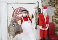 """Martin McLoughlin, owner of Nicky's Plaice fishmongers, poses at his premises in the fishing village of Howth, Dublin, Ireland, Thursday, Dec. 17, 2020. Irish coastal communities will be """"annihilated"""" if Britain's post-Brexit fishing demands are granted, an Oireachtas committee has been told. (Brian Lawless/PA via AP)"""