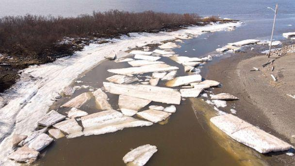 PHOTO: Melting ice beside severe erosion of the permafrost tundra at Bethel on the Yukon Delta in Alaska, April 15, 2019. Alaska has been warming twice as fast as the global average, with temperatures in February and March shattering records. (Mark Ralston/AFP/Getty Images)