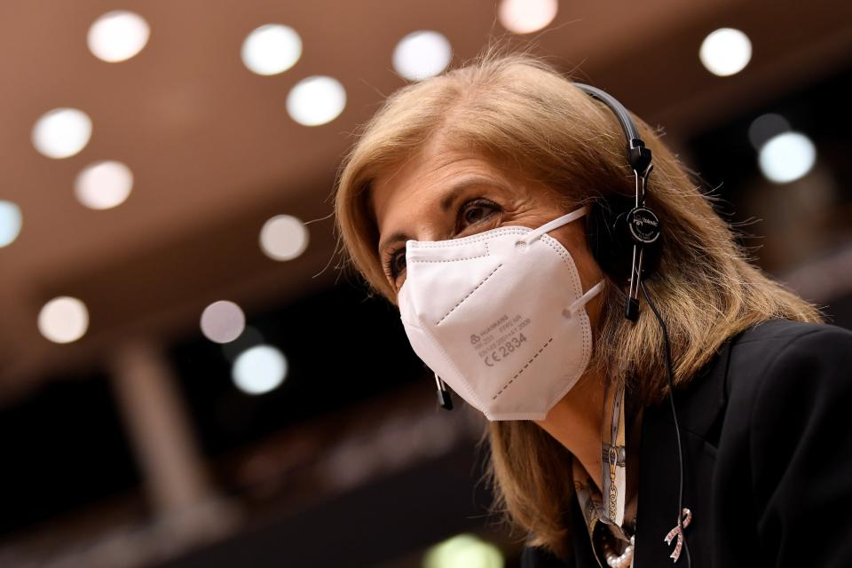 European Commissioner in charge of Health Stella Kyriakides arrives to he main chamber during a plenary session at the European Parliament in Brussels, Tuesday, Jan. 19, 2021. (John Thys, Pool Photo via AP)