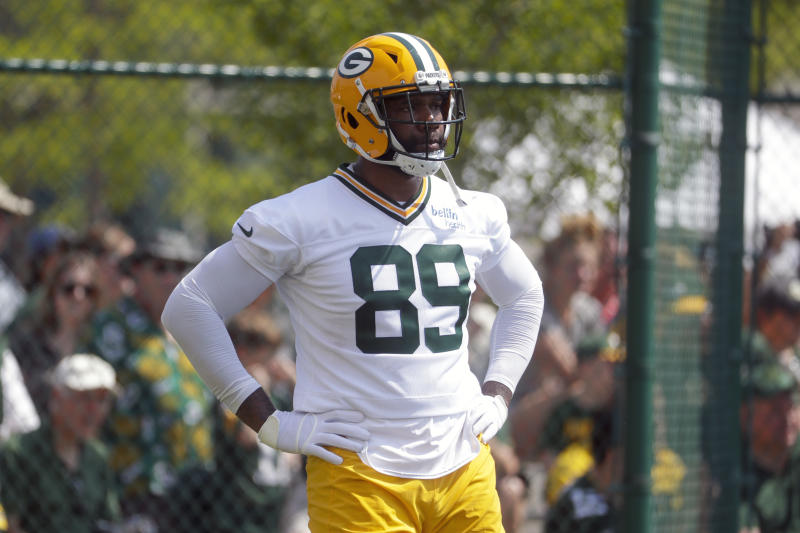 FILE - In this July 25, 2019, file photo, Green Bay Packers' Marcedes Lewis runs a drill during NFL football training camp in Green Bay, Wis. Reporters from The Associated Press spoke to more than two dozen athletes from around the globe -- representing seven countries and 11 sports -- to get a sense of how concerned or confident they are about resuming competition. (AP Photo/Morry Gash, File)