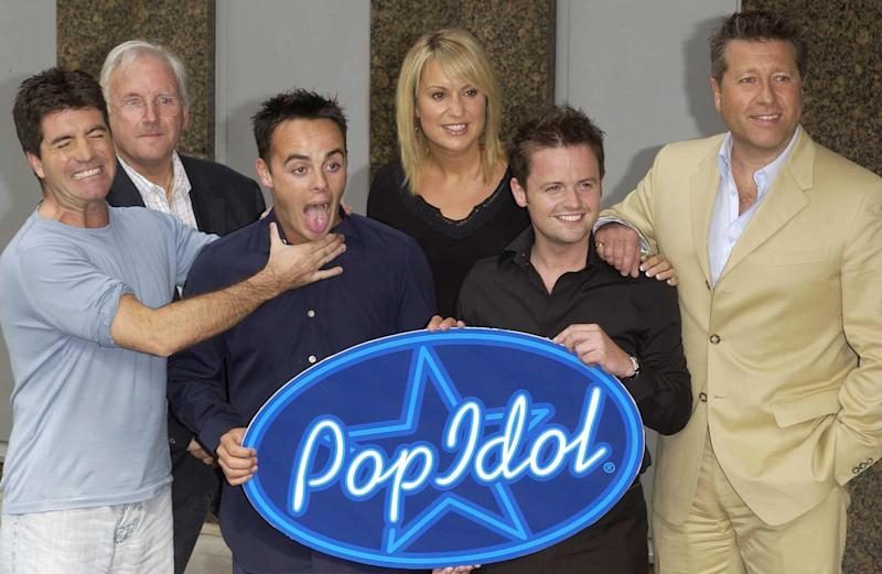 Pop Idol judges (from left) Simon Cowell, Pete Waterman, Nicki Chapman and Neil Fox, pose with show hosts Ant and Dec (Anthony McPartlin & Declan Donnelly) during a press conference at Thames TV in London, to launch a new series of Pop Idol. (Photo by PA Images via Getty Images)