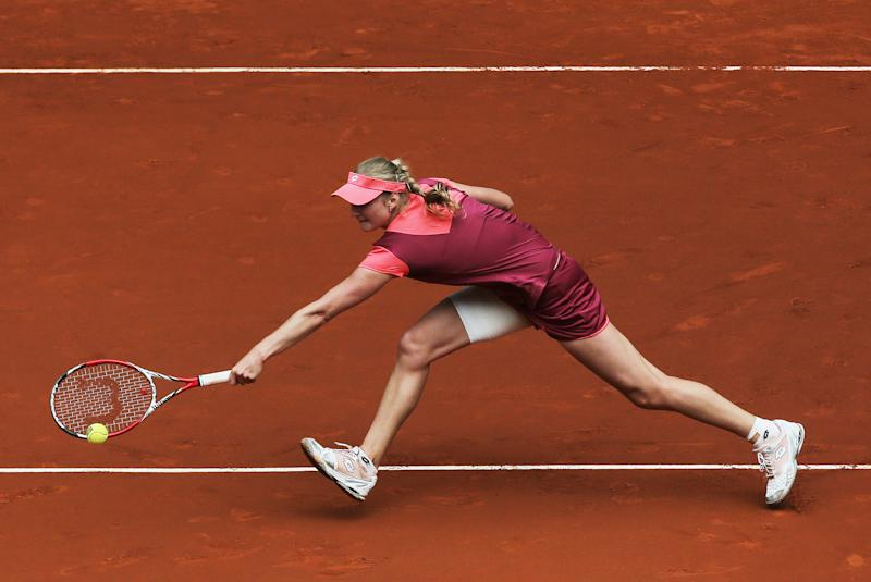 Ekaterina Makarova from Russia returns the ball during the match against Victoria Azarenka from Belarus at the Madrid Open tennis tournament, in Madrid, Wednesday, May 8, 2013. (AP Photo/Andres Kudacki)