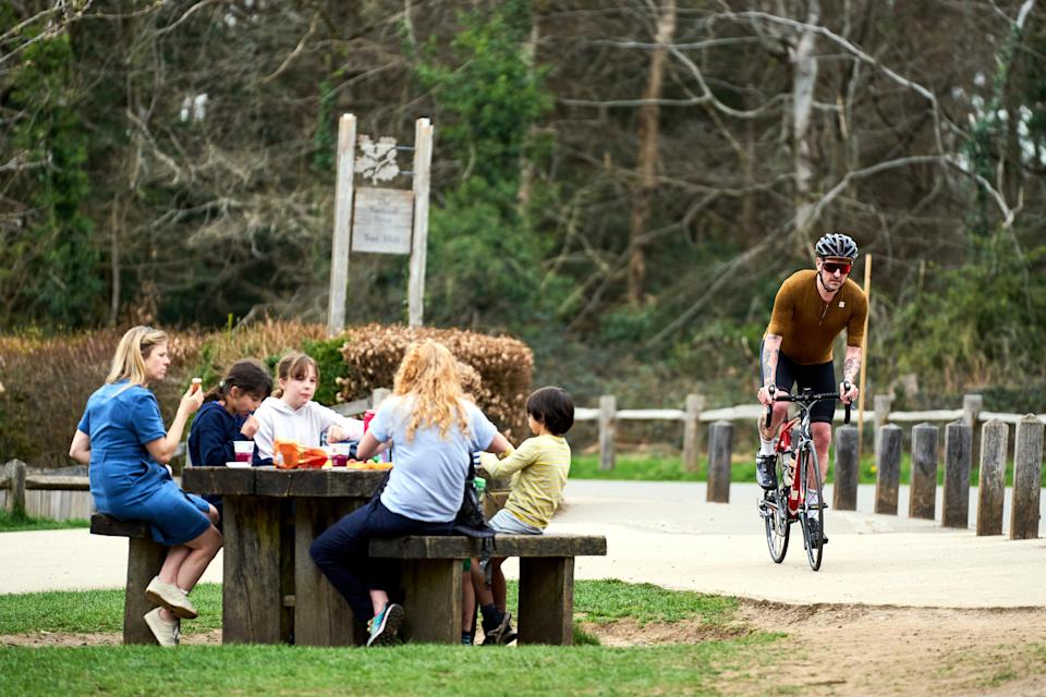 People enjoy the warm weather at Box Hill, Surrey. Picture date: Wednesday March 31, 2021.