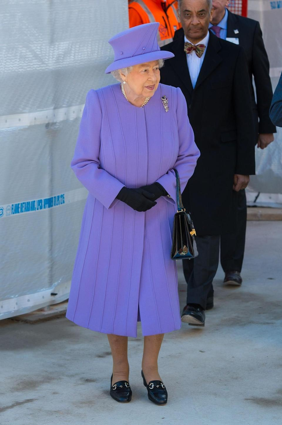 <p>A pleated lilac look appeared on a visit to London's Crossrail site.<br><i>[Photo: PA]</i> </p>