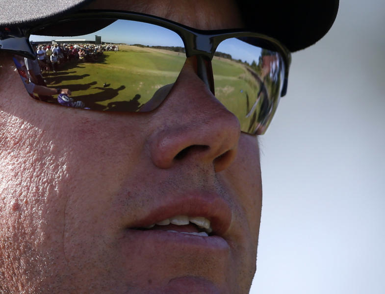 Lee Westwood of England waits to play off the second tee with the fairway reflected in his sunglasses during the second round of the British Open Golf Championship at Muirfield, Scotland, Friday July 19, 2013. (AP Photo/Peter Morrison)