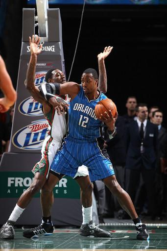 MILWAUKEE, WI - FEBRUARY 20: Dwight Howard #12 of the Orlando Magic posts up against Larry Sanders #8 of the Milwaukee Bucks during the game on February 20, 2012 at the Bradley Center in Milwaukee, Wisconsin. (Photo by Gary Dineen/NBAE via Getty Images)