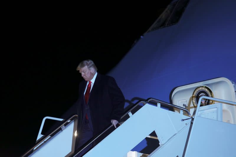 U.S. President Donald Trump descends from Air Force One following a campaign trip to Ohio, at Joint Base Andrews in Maryland