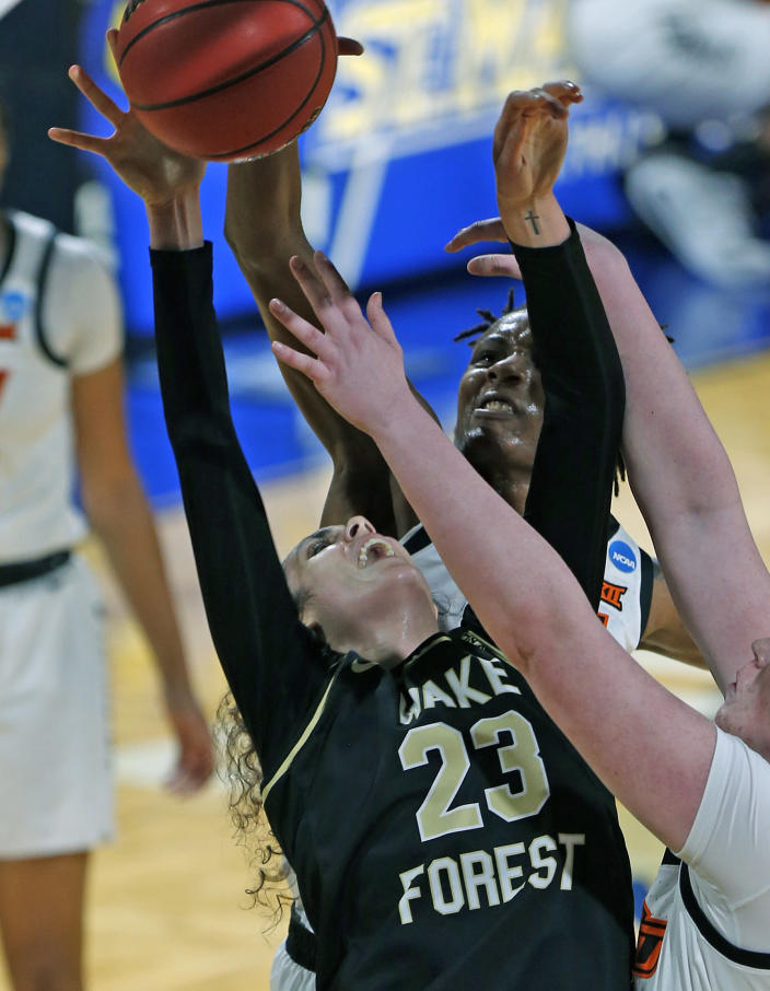 Oklahoma State forward Natasha Mack (4) blocks a shot attempt of Wake Forest forward Christina Mora during the first half of a college basketball game in the first round of the women's NCAA tournament at the Greehey Arena in San Antonio, Texas, Sunday, March 21, 2021. (AP Photo/Ronald Cortes)