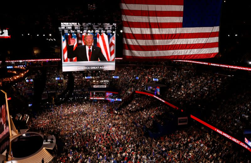 FILE PHOTO: Republican presidential nominee Donald Trump is seen speaking on video monitors during the Republican National Convention in Cleveland, Ohio