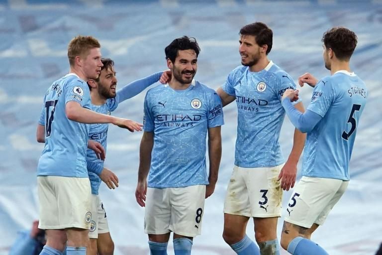 Ilkay Gundogan (centre)struck Man City's second goal in a comfortable win over Crystal Palace