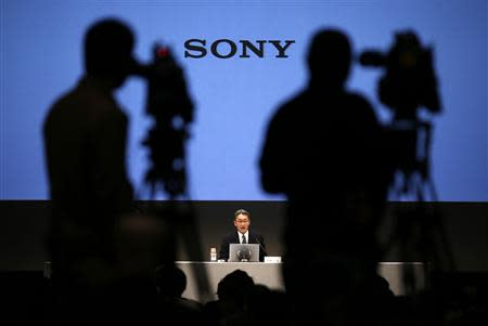 Sony Corp President and CEO Hirai speaks as TV cameramen film during a news conference at the company's headquarters in Tokyo