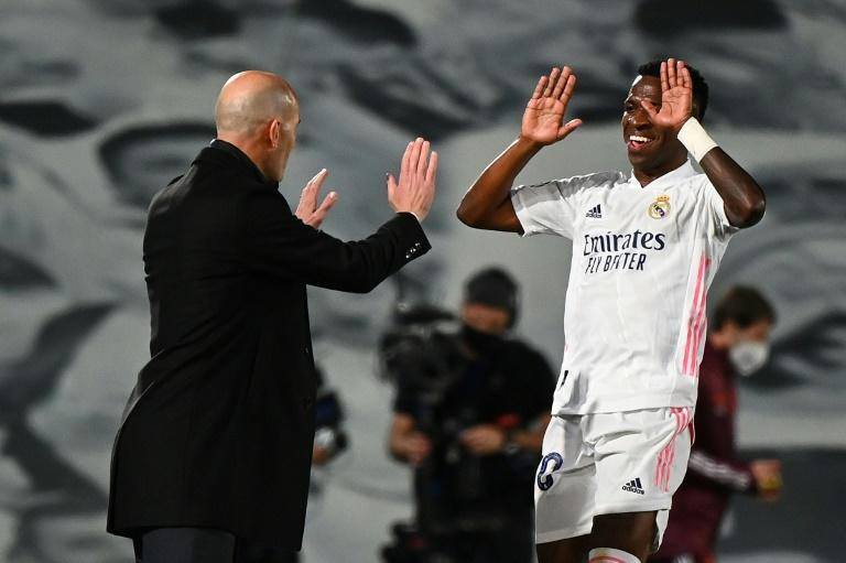 Real Madrid forward Vinicius Junior (R) celebrates with Zinedine Zidane