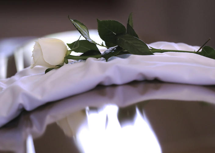 A single white rose sits on the coffin cover during Rayshard Brooks' public viewing at Ebenezer Baptist Church on Monday, June 22, 2020 in Atlanta. Brooks, 27, died June 12 after being shot by an officer in a Wendy's parking lot. Brooks' death sparked protests in Atlanta and around the country. A private funeral for Brooks will be held Tuesday at the church. (Curtis Compton/Atlanta Journal-Constitution via AP, Pool)