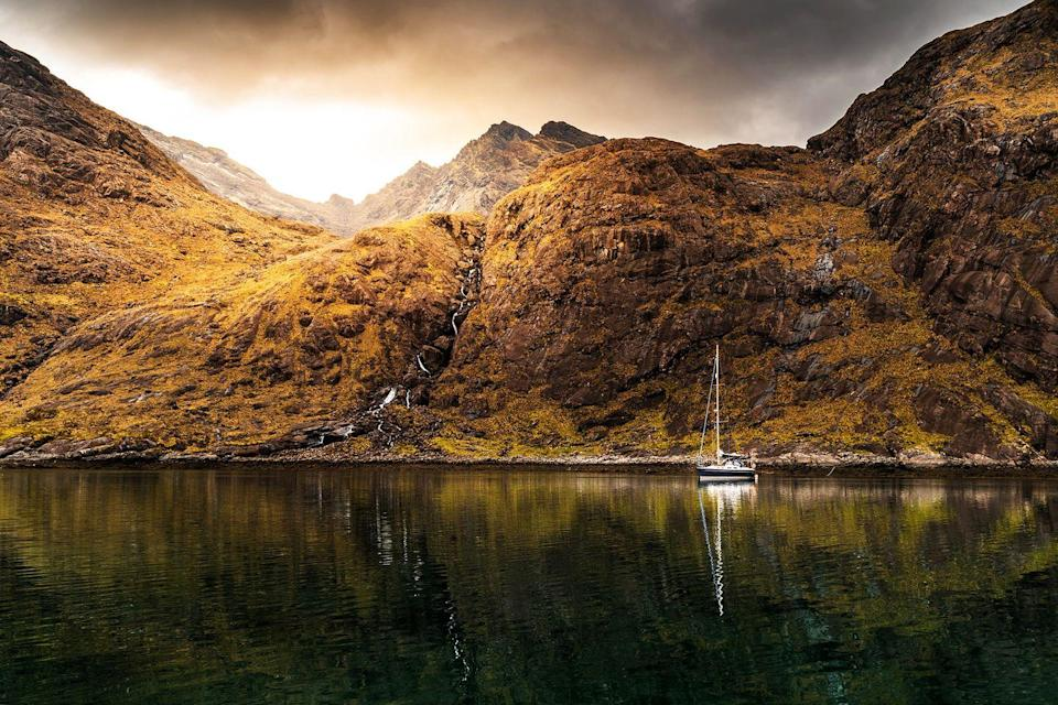 "<p>In the shadow of the Black Cuillin Mountains, Loch Coruisk mirrors an evershifting Scottish sky. Although only accessible by boat or on foot, these deep, dark waters have attracted many an artistic luminary over the years, including Lord Tennyson, Sir Walter Scott and JMW Turner (who almost met an untimely end while clinging to a crag to paint the view). Coire Uisg in Gaelic – meaning 'cauldron of waters' – the lake is the alleged abode of a shape-shifting kelpie: a folklore figure able to assume both horse and human form.</p><p><a class=""link rapid-noclick-resp"" href=""https://www.walkhighlands.co.uk/skye/lochcoruisk.shtml"" rel=""nofollow noopener"" target=""_blank"" data-ylk=""slk:MORE INFO"">MORE INFO</a></p>"
