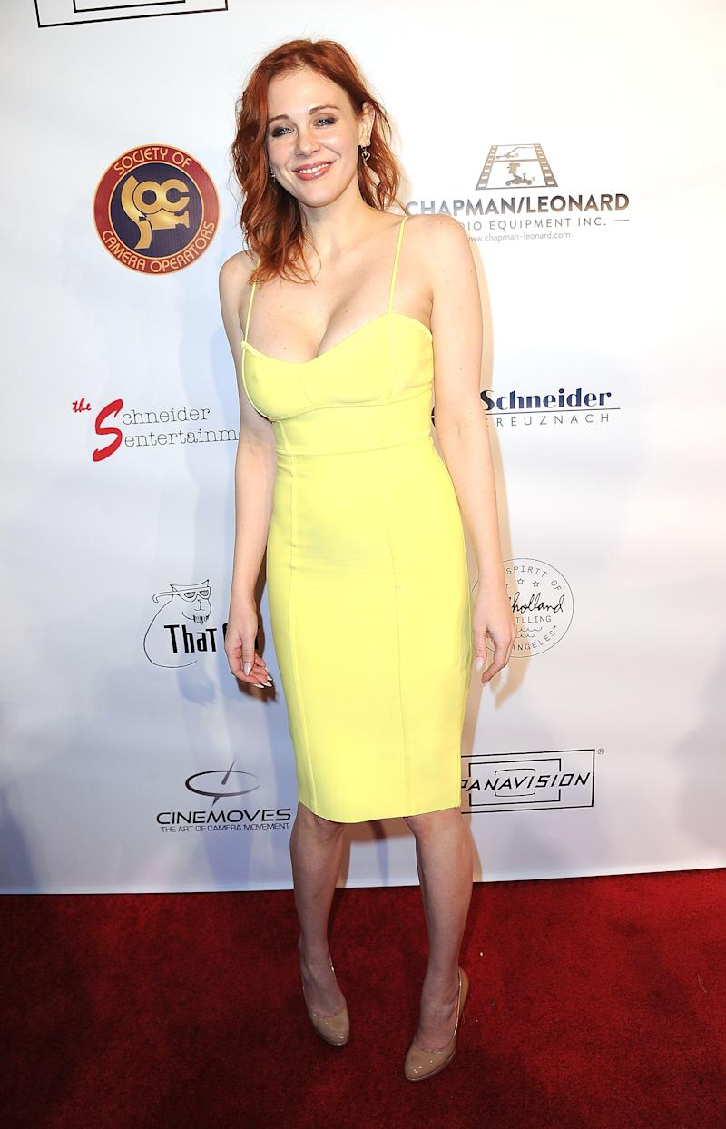 Maitland Ward poses in a yellow dress at an event
