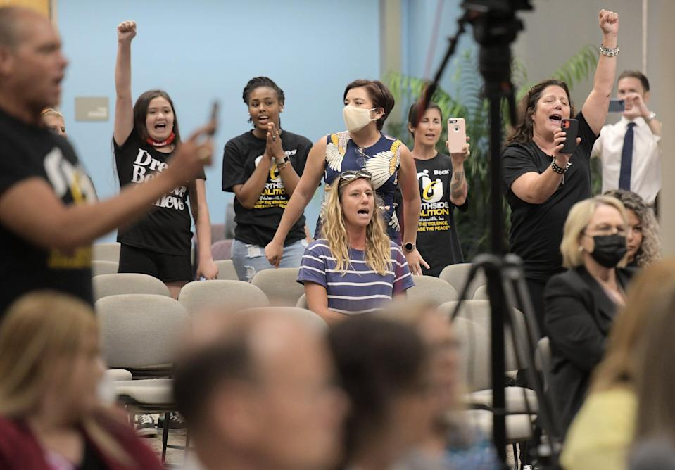 """Audience members joined Ben Frazier, the founder of the Northside Coalition of Jacksonville in chanting """"Allow teachers to teach the truth"""" during public comments on the state's plans to ban the teaching of critical race theory in state public schools."""