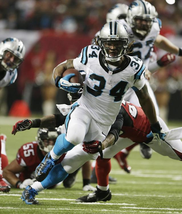Carolina Panthers running back DeAngelo Williams (34) runs against the Atlanta Falcons during the second half of an NFL football game, Sunday, Dec. 29, 2013, in Atlanta. (AP Photo/Dave Martin)