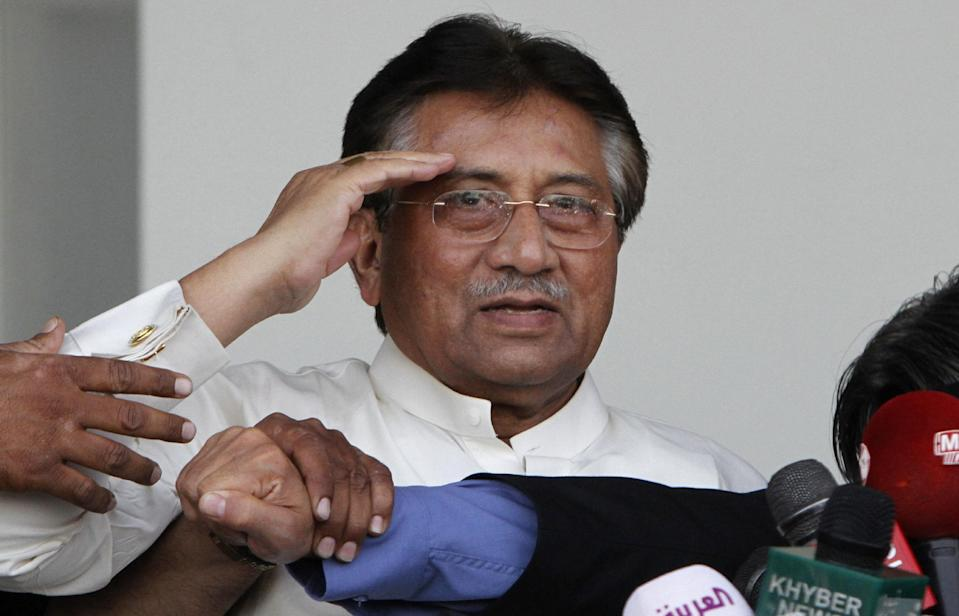 Former Pakistani President Pervez Musharraf, salutes the crowd, upon his arrival to Karachi airport, Pakistan, Sunday, March 24, 2013. Former Pakistani President Pervez Musharraf ended more than four years in self-exile Sunday with a flight to his homeland, seeking a possible political comeback in defiance of judicial probes and death threats from Taliban militants. (AP Photo/Shakil Adil)