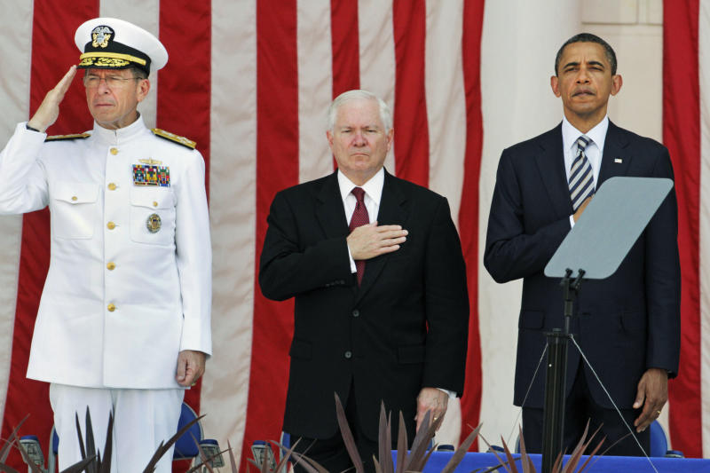 Chairman of the Joint Chiefs of Staff Adm. Mike Mullen, left, Secretary of Defense Robert Gates, and U.S. President Barack Obama stand during taps at the Memorial Day service in the amphitheater at Arlington National Cemetery in Arlington, Va., Monday, May 30, 2011. (AP Photo/Jacquelyn Martin)